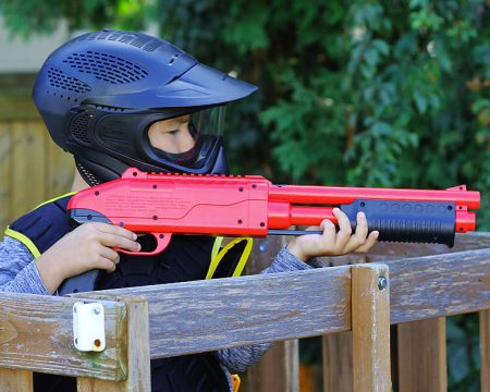 Kid Playing .50 Cal Low Impact Paintball wearing JT SplatMaster Gear
