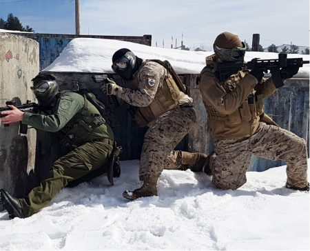 3 men in full tactical gear playing paintball in winter using a variety of markers and G.I. Sportz Frostbite Paintballs